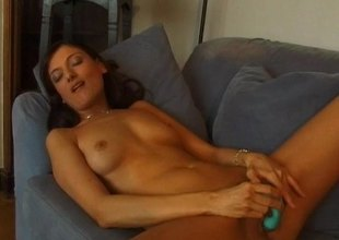 Earthy brunette with a gorgeous pest playing with her shaved pussy