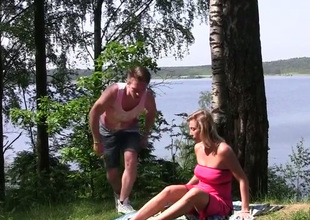 Ardent blond haired MILF lets dude finger will not hear of pussy near the river