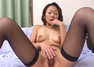 Abrupt haired Japanese brunette in nylons teases cunt with egg love toy
