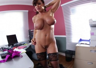 Lisa Ann oils up her large tits together with lets him light of one's life her rack