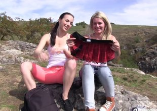 Loose lesbo sweethearts licks girlfriend's coochie in an outdoors shoot