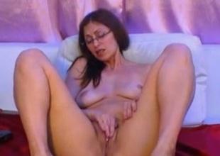 Big-assed milf around glasses fingers her cooch around webcam solo pretend