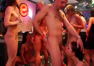 Lingerie clad cutie goes wild on a hollow cumshooter at a club orgy