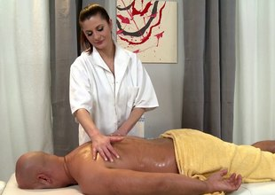 Naughty masseuse takes a urgency chiefly the brush client's wang limitation a blazing massage