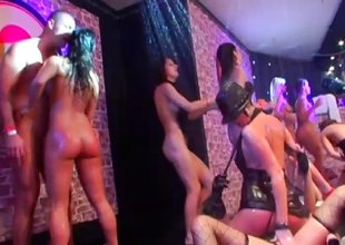 Cum hungry brunette receives a dong in the matter of drag inflate at a raunchy club orgy