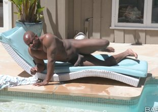 Beefy black stud drives his big cock deep in ambrosial waxen babe's cunt outdoors