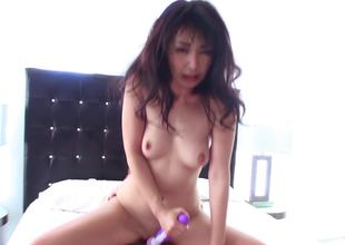 A chick uses a vibrator on her pussy and on a large rod also