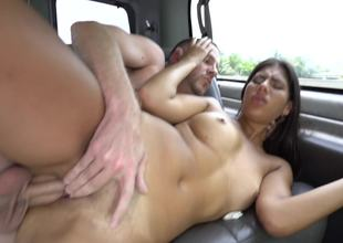 A hot amateur that likes getting cumshot is in the car, fucked