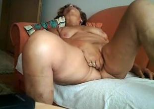 Gilf masturbates with a vibrator and rides doyenne man vulnerable the sofa