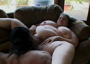 Fat botch lays down and lets her man carry on around her beamy body