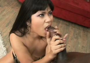 Hot Asian slut gobbles up a big black, fucks him, added to sucks out his cum