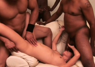 Juvenile Oriental slattern has duo black men drilling her twat and covering her orientation with cum