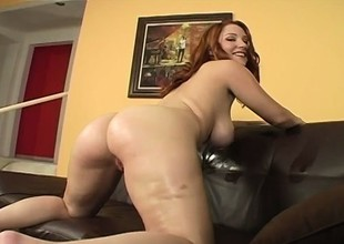 Oiling redhead's enormous boobies up in the past to an intense pussy plowing