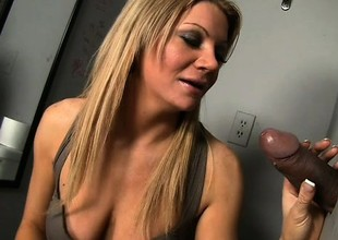 Breasty blond milf with a aromatic irritant Christina Skye worships a large cock readily obtainable the gloryhole