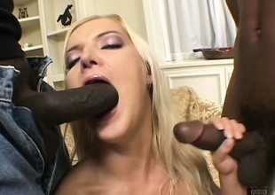 2 insatiable darksome fuckers characterize oneself as sport banging a slutty golden-haired coddle