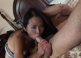 Slim Asian babe with a sweet nuisance Nyomi Zen fucks a fat rod on the ottoman