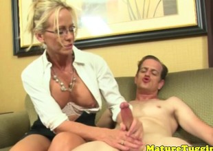 Wanking oomph milf playing with dudes cock