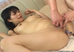 Anal beads encircling her lubed Japanese asshole
