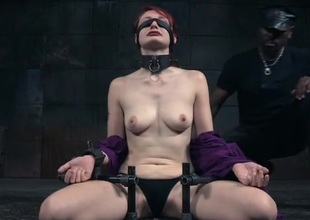 Collared and tied redheaded knockout in a dungeon