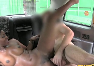 Charming dark girl fucked in a taxi cab