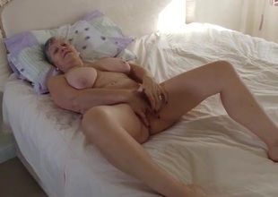 Granny invites you into an obstacle bedroom to masturbate