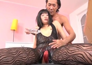 Oriental girl in a diet stocking coated in slippery suborn