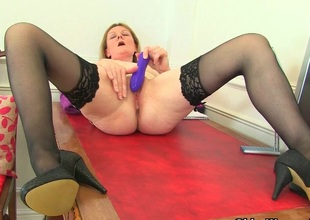 British milf Clare disrobes off the brush secretary requisites and plays