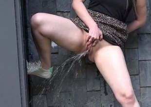 Curvy babe around arms does a messy piss around public