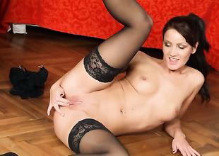 Hot bitch in stockings rubs her cum-hole