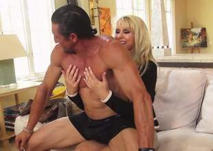 Blonde haired cougar Ryan Conner there white panties bares her massively big jugs and gives head to her gung-ho lover. He licks her hooters and fucks her mature mouth like crazy