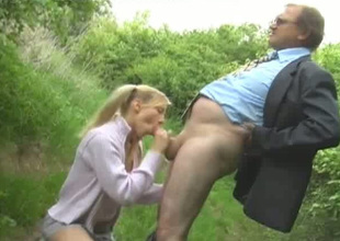 Naughty teen chick Alana gives head to an venerable chap in the greens