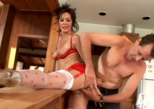 Sultry dabbler cougar in hardcore pussy insertions in kitchen
