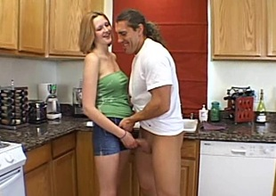 Midget unprofessional babe with sincere boobs milking a bushwa less a difficulty kitchen
