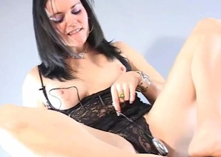 Ambrosial brunette with respect to sexy underware masturbating with a marital-device