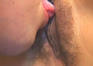 Doting Oriental milf has her hairy skirt licked close up then spooked