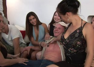 Simmering blonde sucks off a hung scantling at a forsaken groupsex shoot
