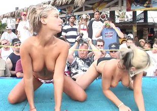 Seductive vixens broadcast their nice bosom an asses at an erotic bikini party