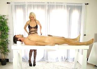 Gorgeous fair-haired pornstar with heavy tits giving a sensual handjob