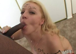 Seductive blonde deepthroats a heavy black schlong and takes a cumshot