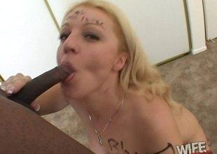 Seductive blonde deepthroats a heavy black schlong and takes a cumshot