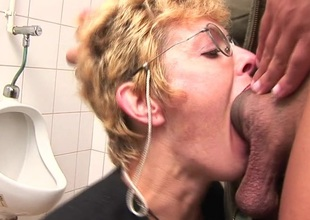 Lustful flaxen-haired matured slut sucking cock on put emphasize men's room