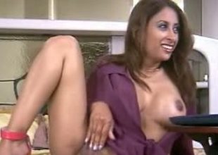 Frisky Indian model is poking her vagina nigh dealings toy