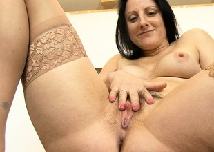Chubby brunette MILF rubs her soft cunt with a toy in her meeting