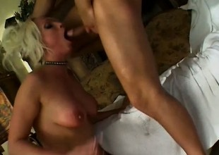 Opprobrious blonde cougar Nikki Hunter welcomes a stiff prick in each hole