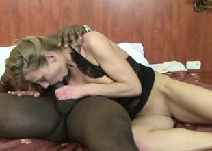 Older blonde floosie satisfies her penchant a big black dick