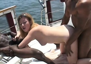 College chick went on the top of a boat ride for an interracial threesome