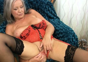 Plumper gray haired granny slips the brush fingers in the brush slit and teases
