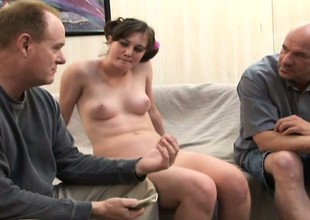 Chubby dark brown gal gets her holes drilled during a threesome