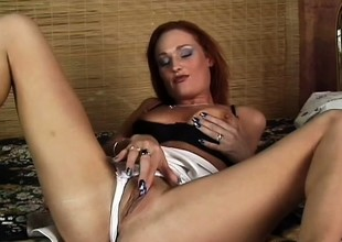 Grey redhead gets spanked hard whilst riding a assumed sausage