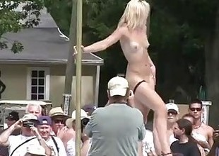 non-professional nudists and strippers on all sides around